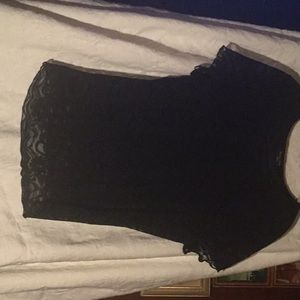 Short sleeve black lace top. Like new,lined.